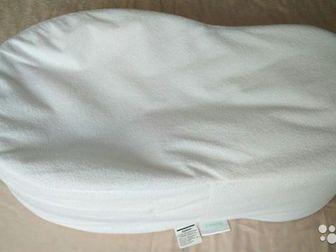 Продам Кокон (колыбель для новорожденных) в отличном состоянии,  В комплекте 2  съёмные наволочки: махровая водонепроницаемая и плотная хлопковая, очень мягкая, в Новосибирске