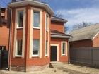 Двухэтажный дом из красного кирпича.металлопластиковые окна,