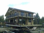 Дома из профилированного бруса 200*200 мм изготовлением домов из проф. бруса сеч